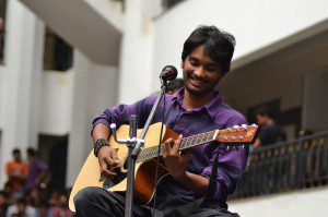 Mahesh playing the guitar