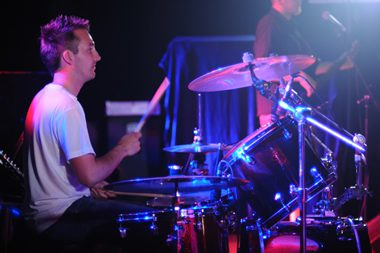 drummer playing on stage