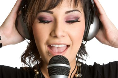 girl_singing_into_microphone