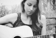 Maggie Pope playing guitar